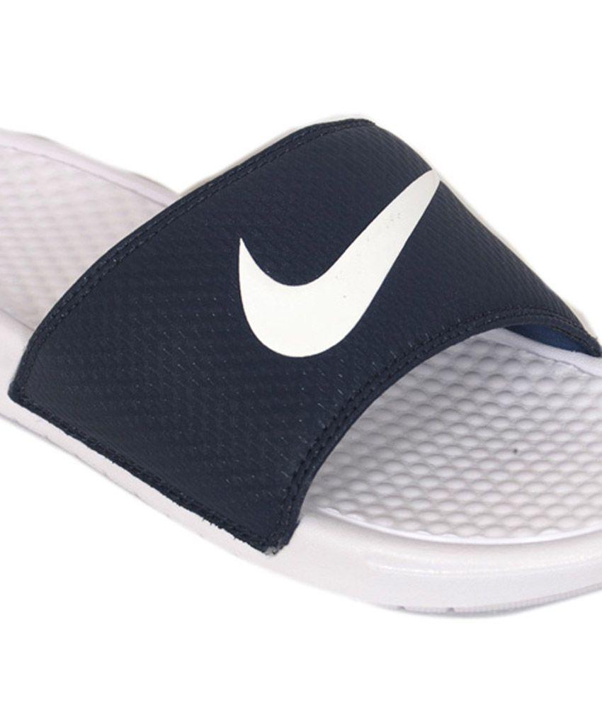 d441532302ae63 Nike Benassi Swoosh White Slippers ... wholesale outlet 73ce0 7f1c9  Nike  Benassi Swoosh Slides for Men - Blue ...