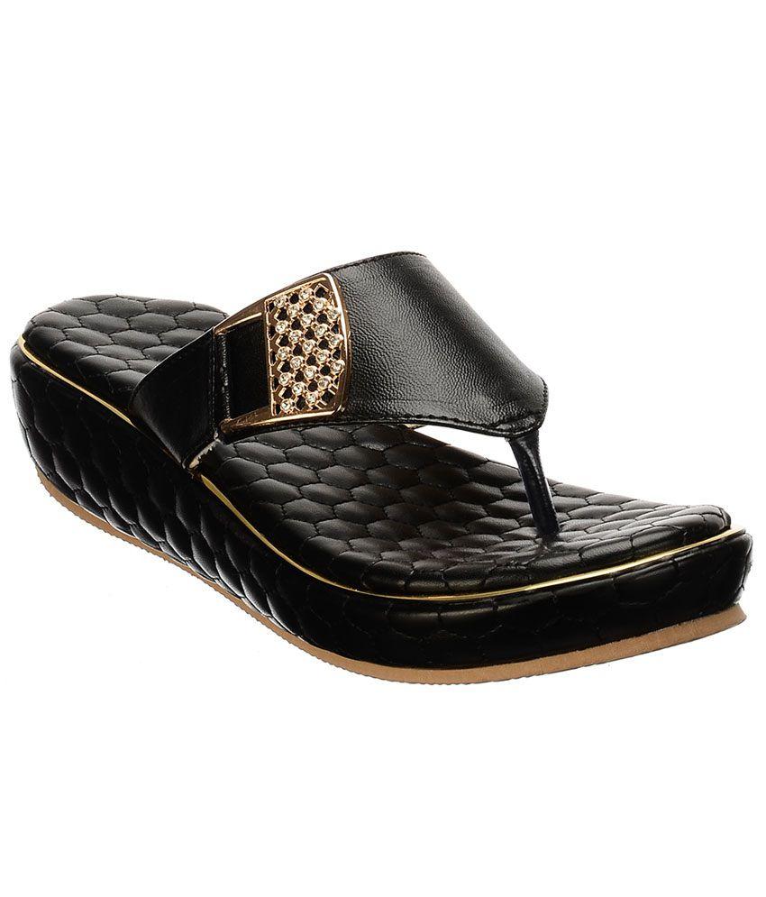 Callie Brown Black Slip-ons