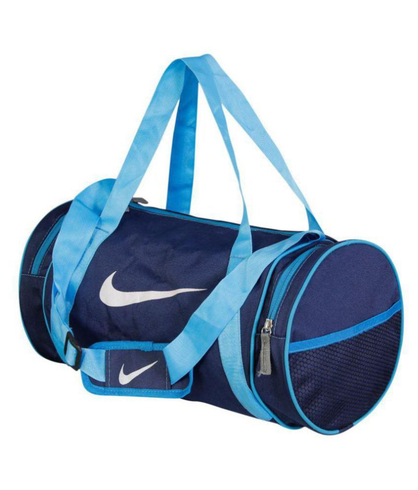 Nike Medium Blue Nylon Gym Bag Travel Duffle For Men   Women Gym Bag - Buy  Nike Medium Blue Nylon Gym Bag Travel Duffle For Men   Women Gym Bag Online  at ... bd0b2173ba598